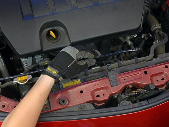 If not, use one hand to hold the hood open temporarily while securing the hood with the prop rod: