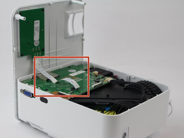 Remove the ribbon cable connecting the motherboard to the button control board by gently pulling it from its connector.