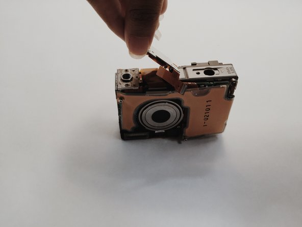 Remove screws and metal shield at the bottom of the camera