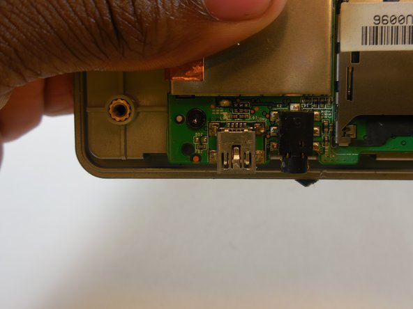 Image 1/3: Lift circuit board up, after making sure its cool, to see if four corners are all connected.