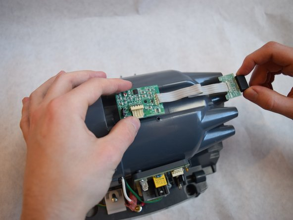 Carefully remove the sensor board from your device.