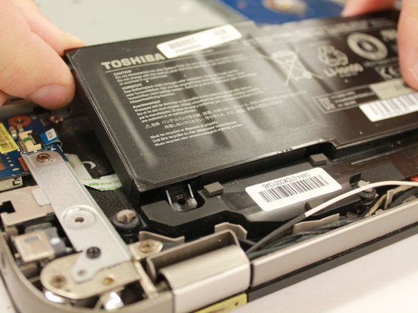 Gently remove battery from the laptop.
