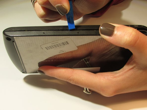 Carefully pry open all 4 sides of the Archos 5 using the plastic opening tool.