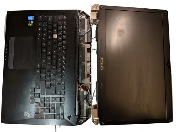 Detach the screen from the hinges of the laptop.