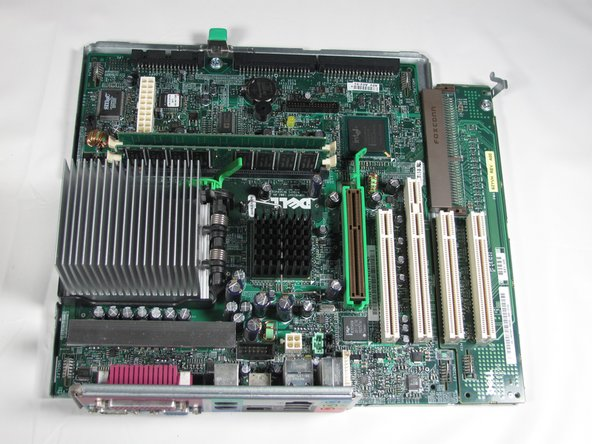 Remove the screw at the rear of the motherboard.