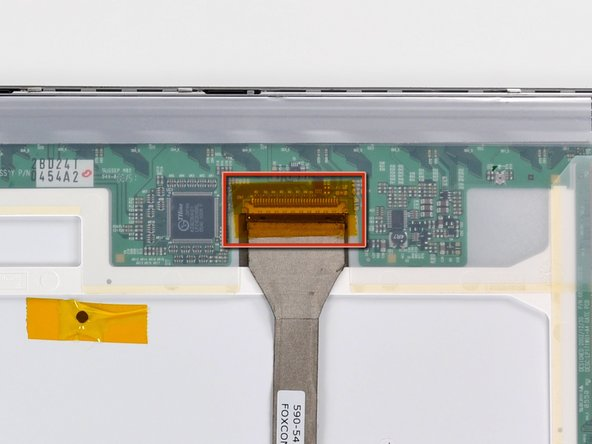 If necessary, remove the piece of tape covering the display data cable connector.