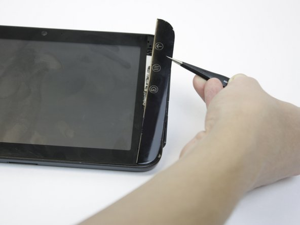 Remove the button cover by lifting the cover away from the tablet.