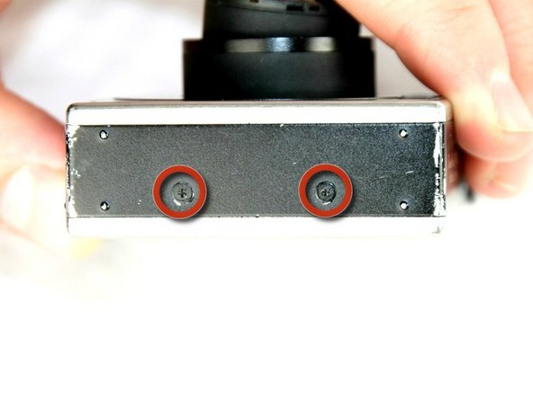 Remove the two screws from the side panel closest to the camera lens.