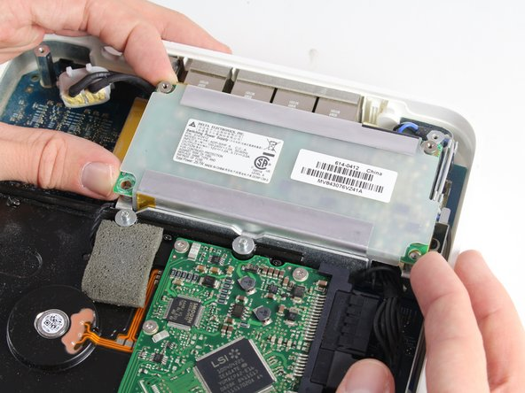Lift the internal power supply brick out of the device.