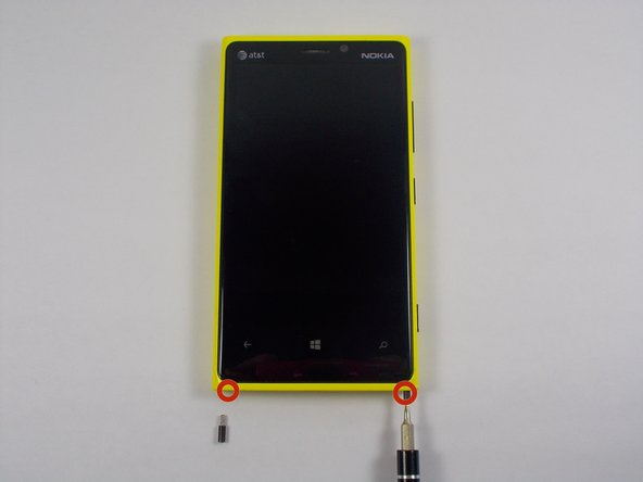 Use the T5 screwdriver to remove the two 8.6mm long screws, located at the bottom of the phone. (Head size is 2.5mm)
