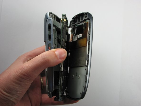 Use a spudger to carefully separate the back panel from the front panel to access all the various components inside the phone.