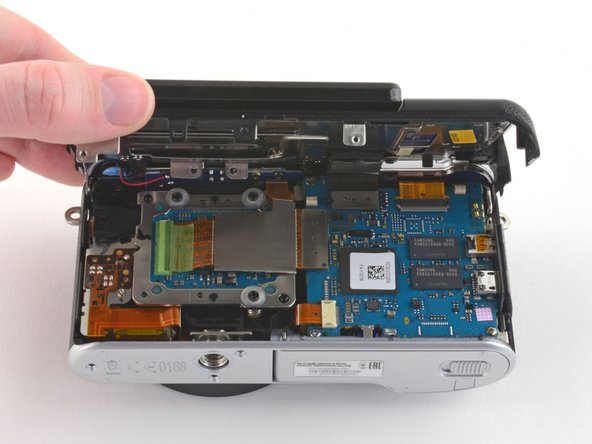 Do not attempt to remove the back case as it is attached to the motherboard by a ribbon cable.