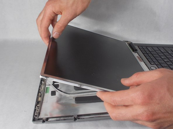 Lift the screen up and fold over gently.