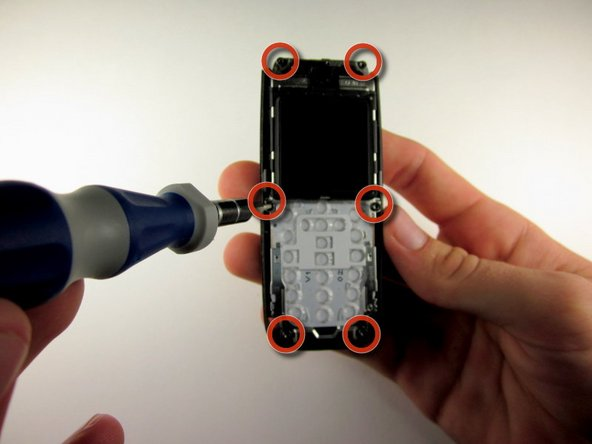 Use the Torx screwdriver with the T6 attachmet  to remove the 6 .4 mm screws around the outside of the circuit board.
