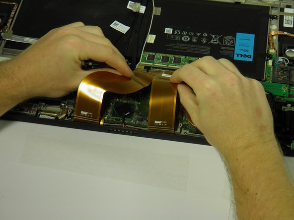 Disconnect the screen and copper colored motherboard cables and tuck them under the device to prevent future hassle.