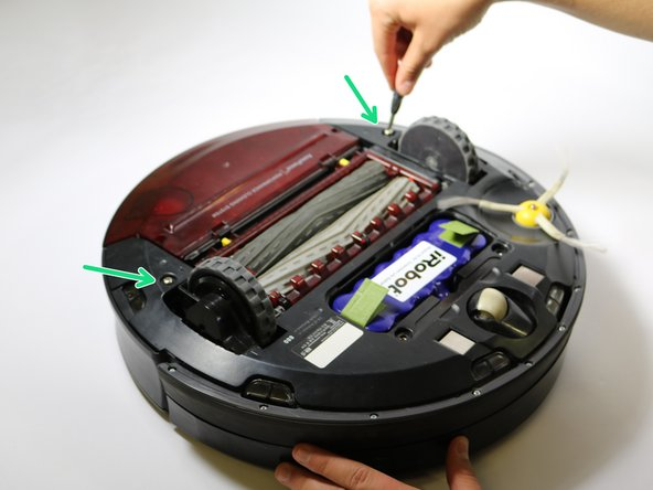 Loosen the single screws that retains the side wheel to the Roomba.