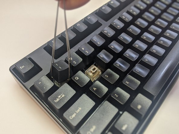 Proceed to remove the surrounding keycaps.