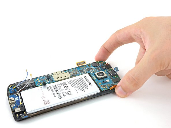 Image 1/2: Grip the motherboard on both edges toward the top of the device.