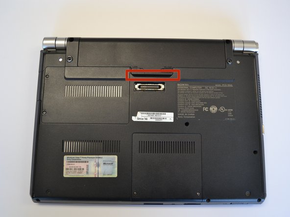 Use a fingernail or plastic opening tool lift the battery while holding the release latch.Rotate the battery up and away from you to remove it from the laptop.