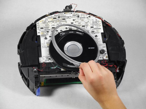 Remove the outer silver circle, black plastic cover, and black film from the central control board in that order.