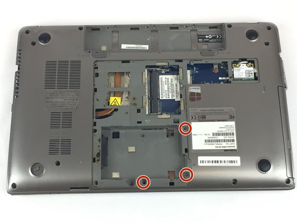 Remove the three 3mm Phillips #0 screws from the hard drive.