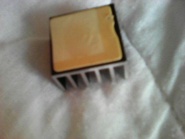 I decided to pry off the heatsink for 2 reasons: 1) I want to see what kind of CPU it is. 2) Maybe reuse it for my RPi.