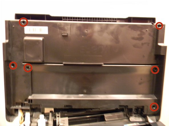 Locate the six 3mm Phillips #2 screws under the lid of the printer and remove them.