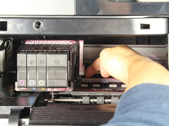 Pull the white plastic tab on the right of the printhead toward you on an upward swing to unlock the printhead.