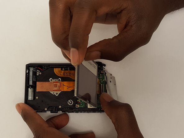Image 1/2: Fold the LCD display over the camera.