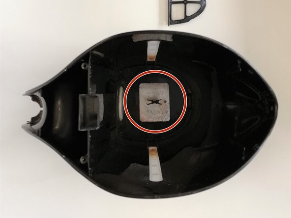 Remove the metal plate from the bottom of the inside of the kettle by pulling up on it to release it from its snapfit.