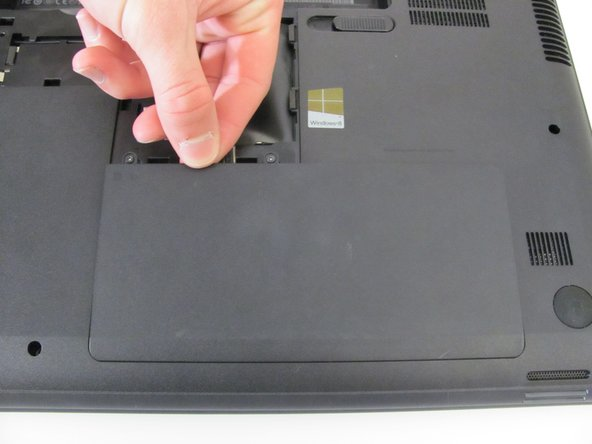 Screws are permanently attached to the hard drive compartment cover. Do not try to remove completely.