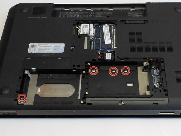 Remove the screws from the hard drive compartments, and place them in the matching places on the diagram.