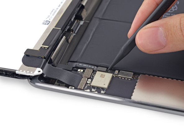 Use the tip of a spudger to lift the home button cable up off of its socket on the logic board.