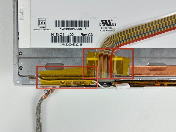 Image 1/3: Remove the pieces of tape securing the display data cable and camera cable to the display.