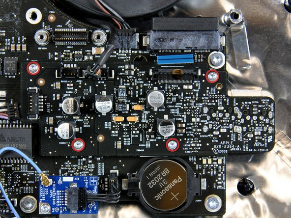 Remove the four T6 Torx screws securing the audio board to the logic board.