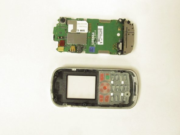 Image 2/2: Now, the front housing is free to be replaced, as well as the cosmetic keypad.