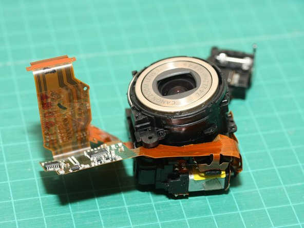 Image 1/1: So here is the lens module again,  with the 2 halves pulled slightly apart to clean the sensor and/or inner lens elements. It was easier to disassemble the camera the 2nd time :-)