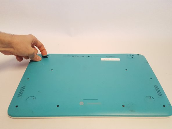 Image 2/2: Remove the middle rubber screw cover.