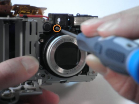 Lastly, remove the final screw directly under the left side of the viewfinder (on the lens side).