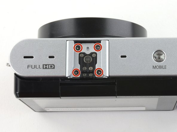 Remove the four 5 mm Phillips screws from the external flash mount .
