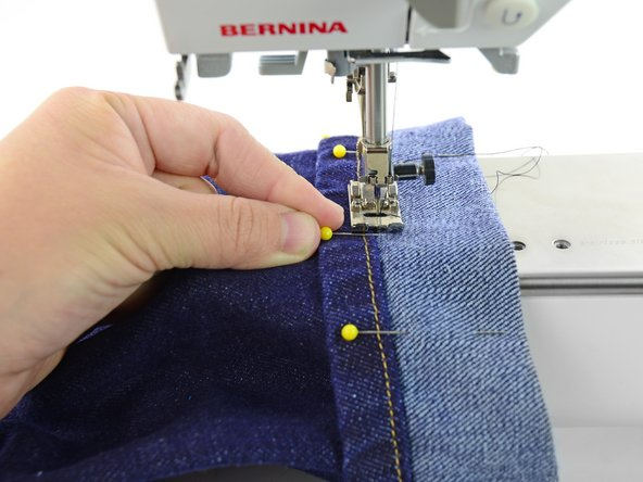 When you come to the first pin, stop sewing.