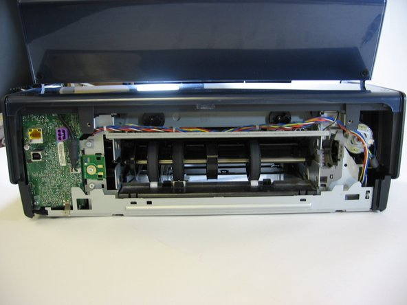 Next, you'll need to remove the top (lid-portion) of your printer. Essentially, it's the shell that hides your printers' innards.