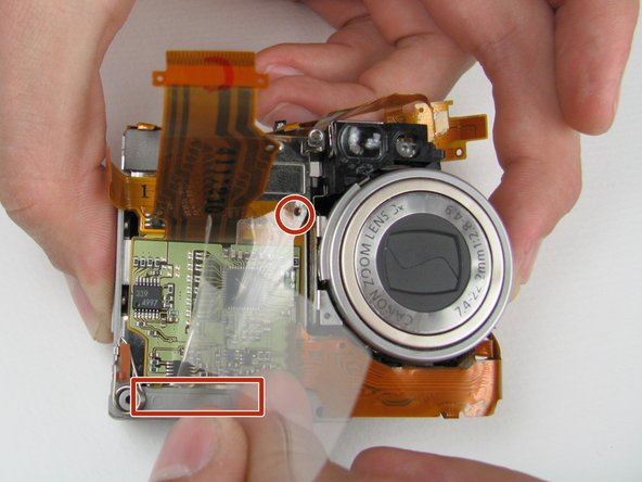 Pick up the remaining battery casing and zoom lens.