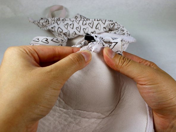 Push the underwire into the hole until it is no longer visible.