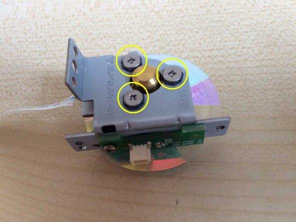 Remove 2 small screws  and remove the black plastic piece.