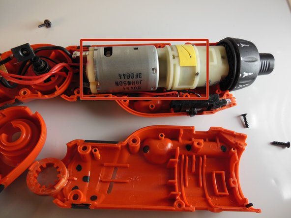 Image 1/1: However, do not pull too hard because the motor is attached to other components of the drill by wires.