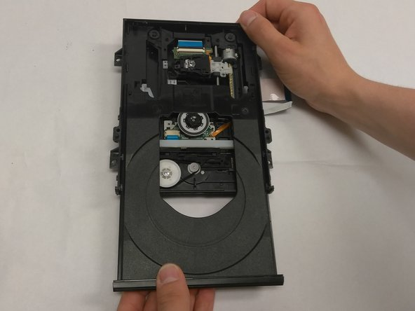 If the disk tray does not come out easily don't force it out this could break the gears that allow the tray to move. Gently lift the disk tray upwards while sliding it out.