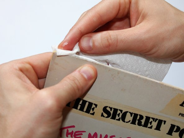 Using a paper towel, wipe excess glue from cover.