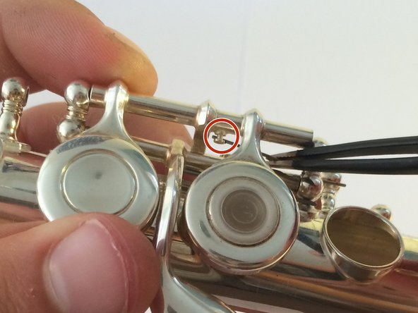 To make the removal of the inline G keys easier, use tweezers to move the spring out of position.