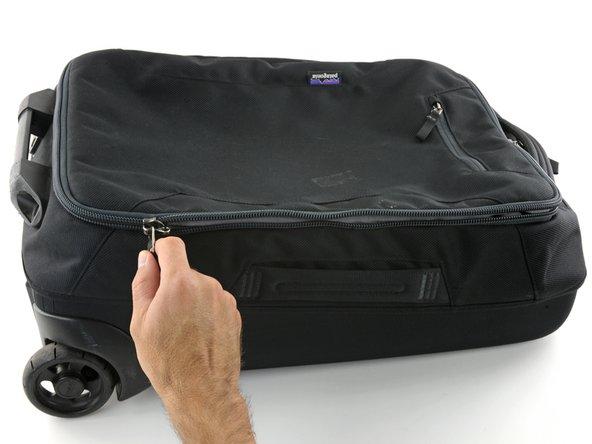 Unzip the main compartment.